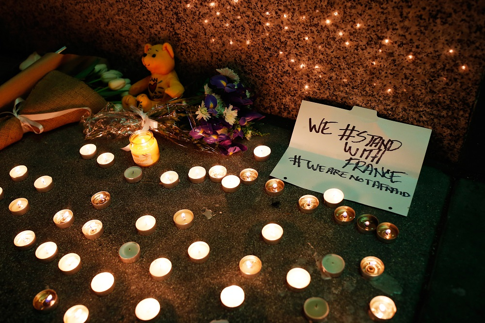 A makeshift memorial honoring the victims of the terror attack in Paris is seen outside the Consulate General of France in San Francisco, California